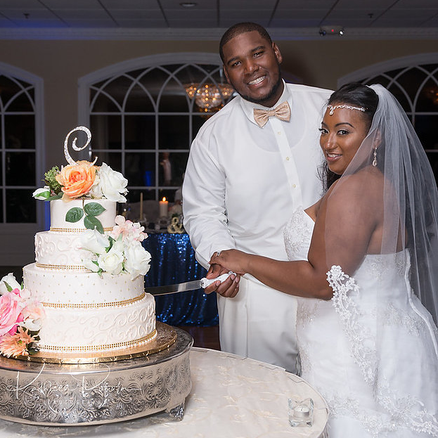 """The Bride and Groom cutting their wedding cake """"Kathleen Popola Photography"""""""