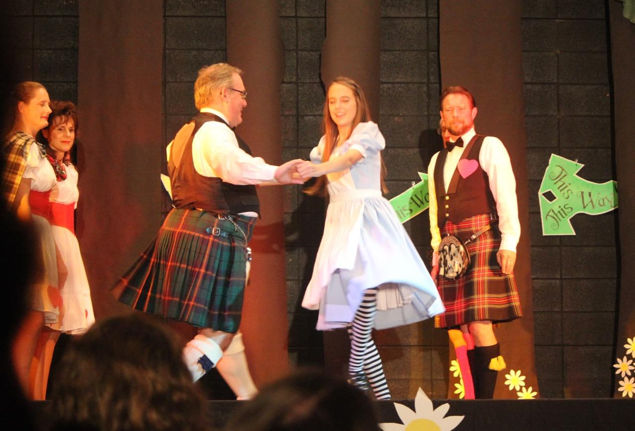 Alice joins in the Dance