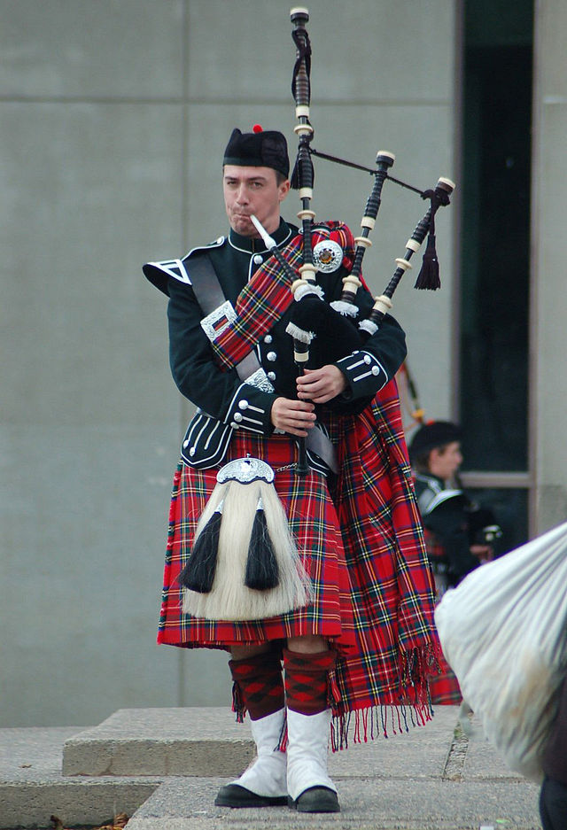 Bagpiper wearing a full plaid
