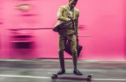 Business-guy-skateboard-moving-forward