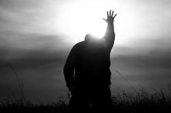 Man-reaching-out-help