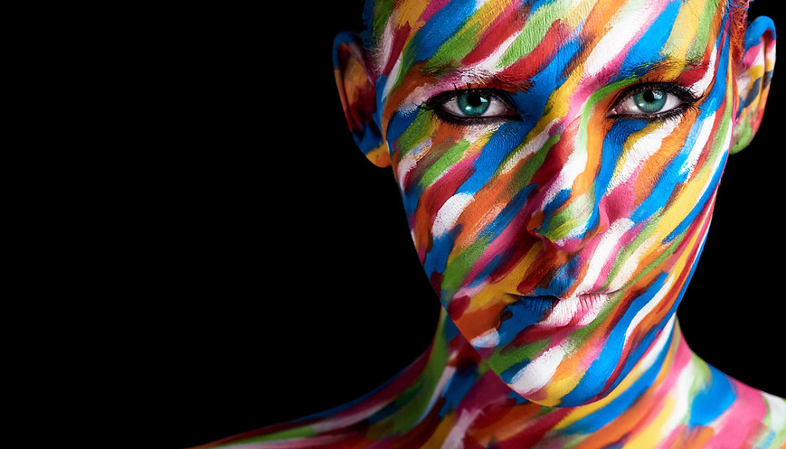 Girl-multi-coloured-painted-face-individ