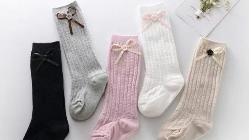 Knee high button bow socks
