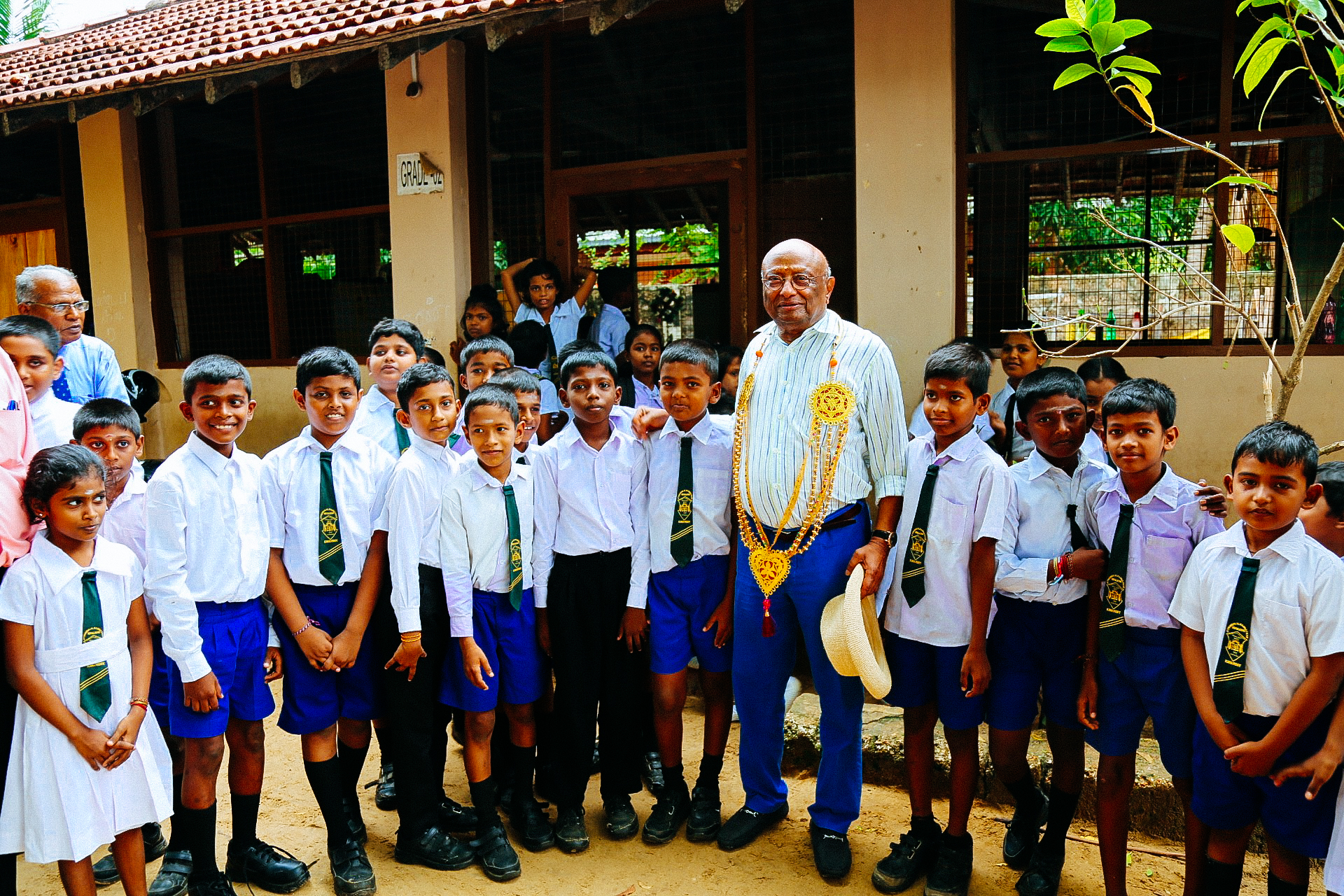 Ian Karan with school kids