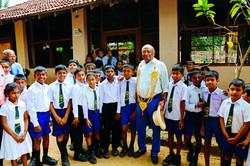 Ian Karan with school kids