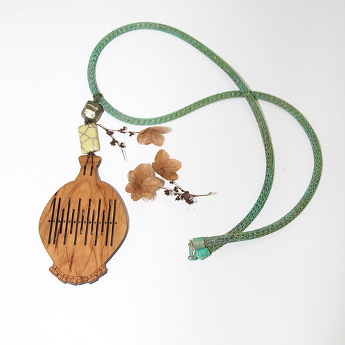 Heddle Pod necklace, on patina woven brass
