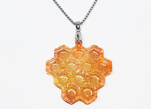 Orange amber honeycomb resin necklace pendant jewelry front
