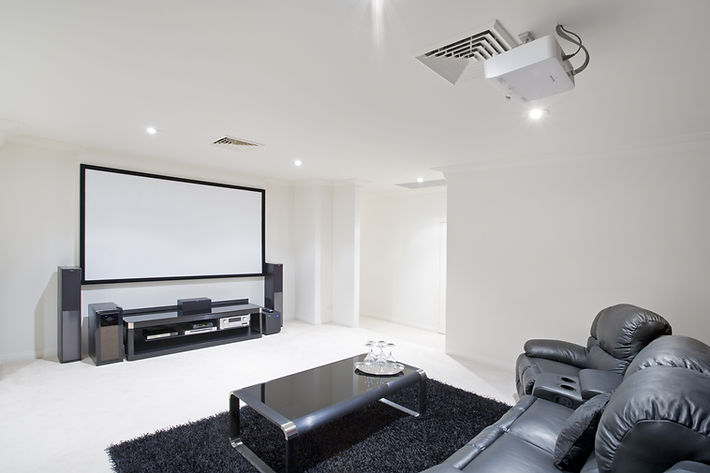 home theater room with black leather rec