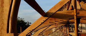 Arch braced oak trusses with hand carved mouldings for an old farmhouse roof in Snowdonia