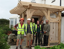Davies-Hughs & Sons Oak framing on site team on Pen Llyn, North Wales