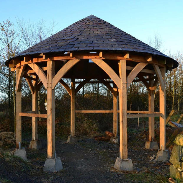 Oak Framed & Conical Roofed Bespoke shelter - made using oak from the nearby Conwy Valley and Welsh slate.  Looking to add something special to your garden this year?  Contact us to discuss your ideas.