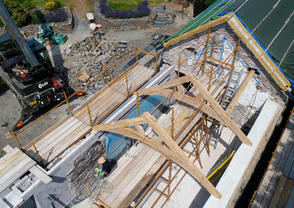 Arch brace trusses being installed onto an old Snowdonia Farmhouse renovation