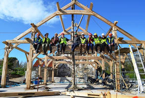 The CLAS visitor centre extension oak frame at Felin Uchaf Centre with the trainees and volunteers that helped make and raise the frame.