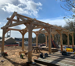 Garage oak frame installation in Abersoc