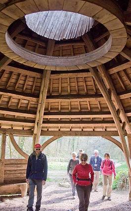 Timber framed turf roofed visitor centre in bishops wood