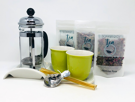French tea press set with colorful teacups