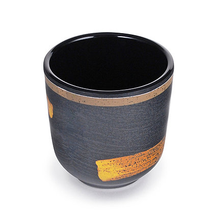 black teacup with gold accent