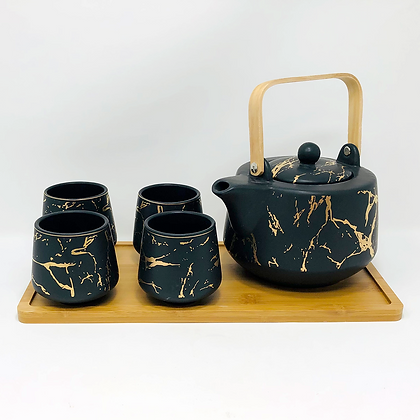 black and gold marble tea set with tray