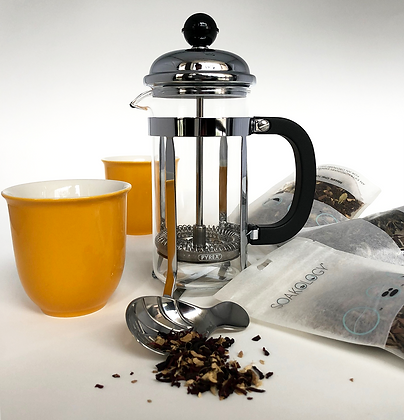 French tea press brew kit with colorful teacups