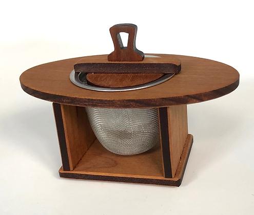 wooden tea nest inscribed with Soakology logo