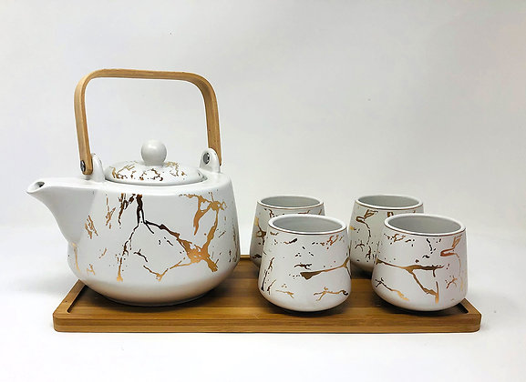 white and gold marble tea set with tray