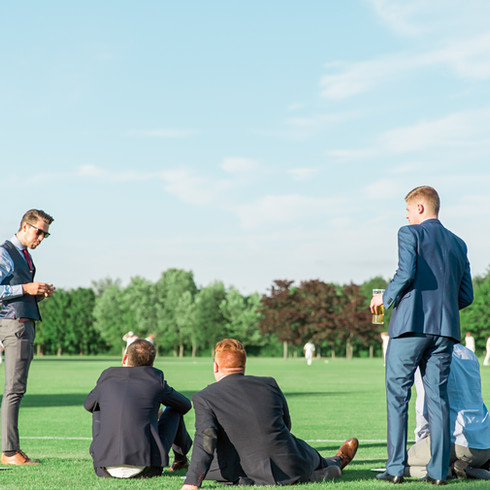 Wedding Guests watching cricket at outdoor reception