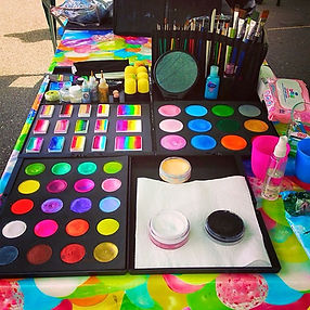 A set of beautiful, high quality face paints displayed on a table. Photo credit Emily's Entertainment