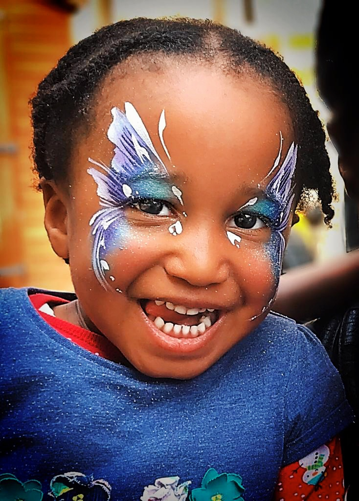 Beautiful blue butterfly face paint