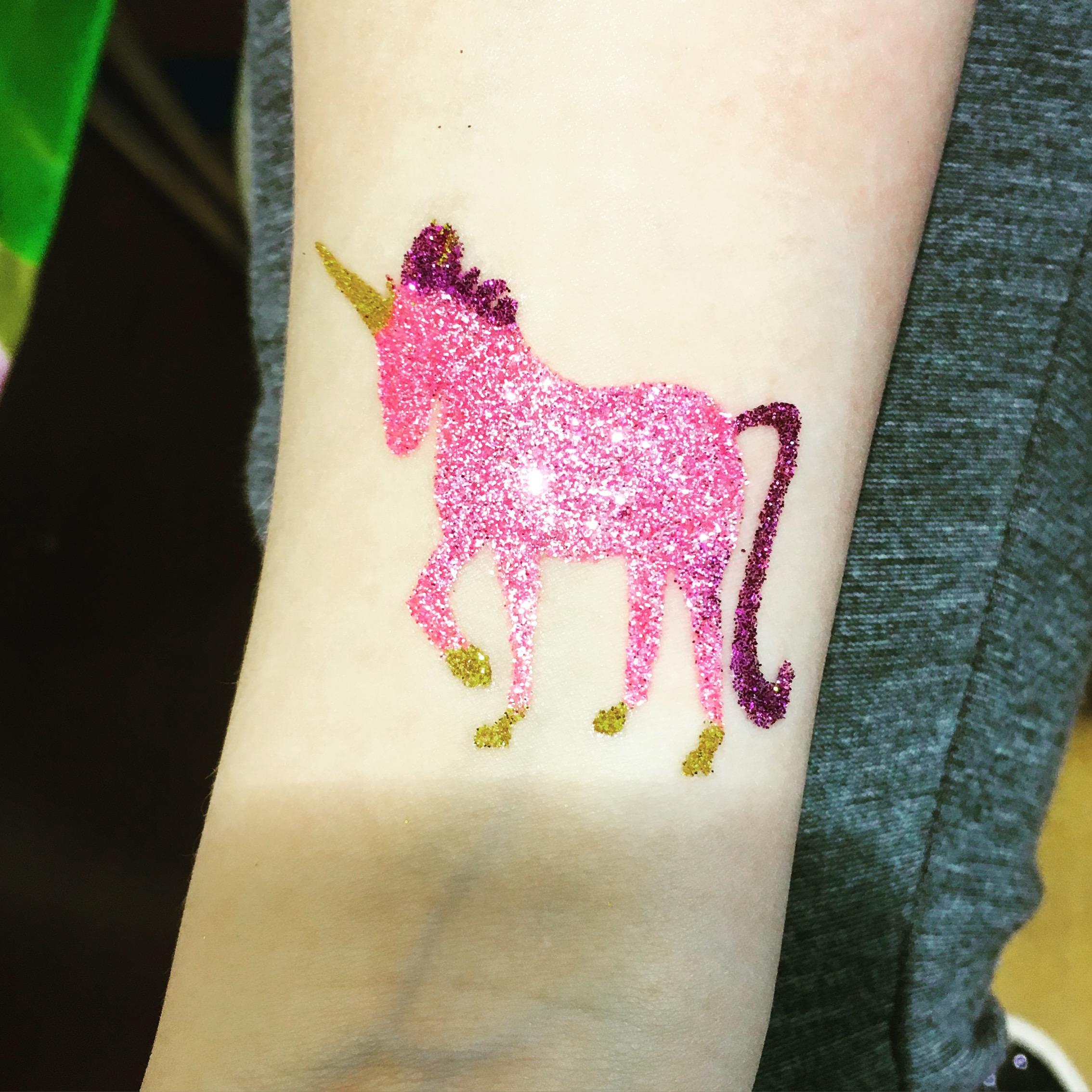Pink unicorn glitter tattoo