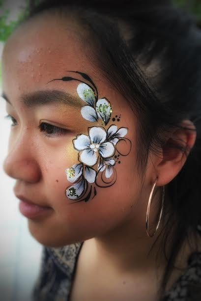 Glittery flower face paint