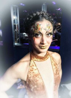 Gold face paint for dancer