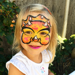 Yello and pink dinosaur face paint