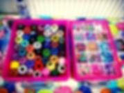Rainbow coloured threads and multi coloured beads. A hair braiding kit provided by Emily's Entertainment.