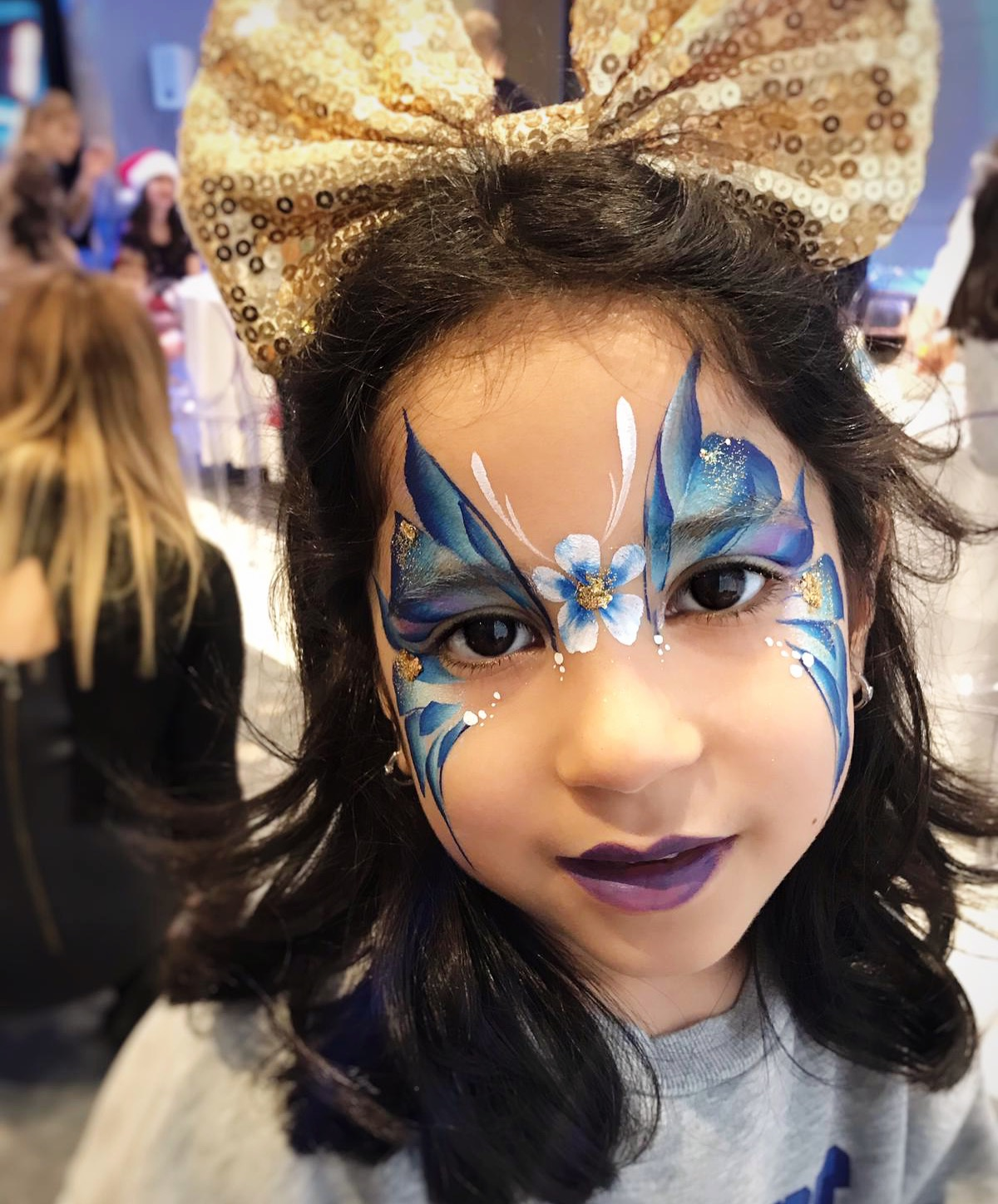 Blue butterfly face paint