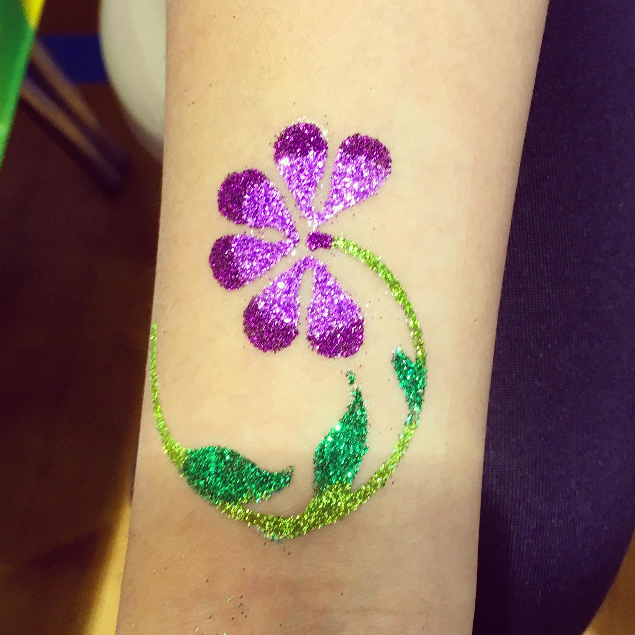 Purple flower glitter tattoo