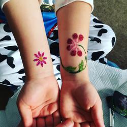 Pink fower glitter tattoos