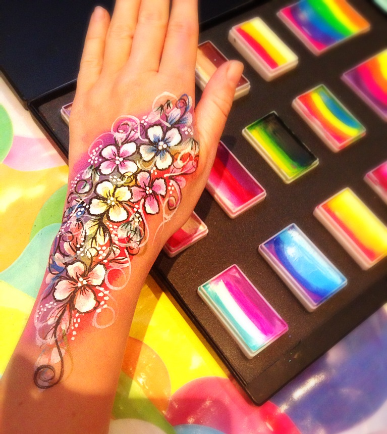 Rainbow flowers body art