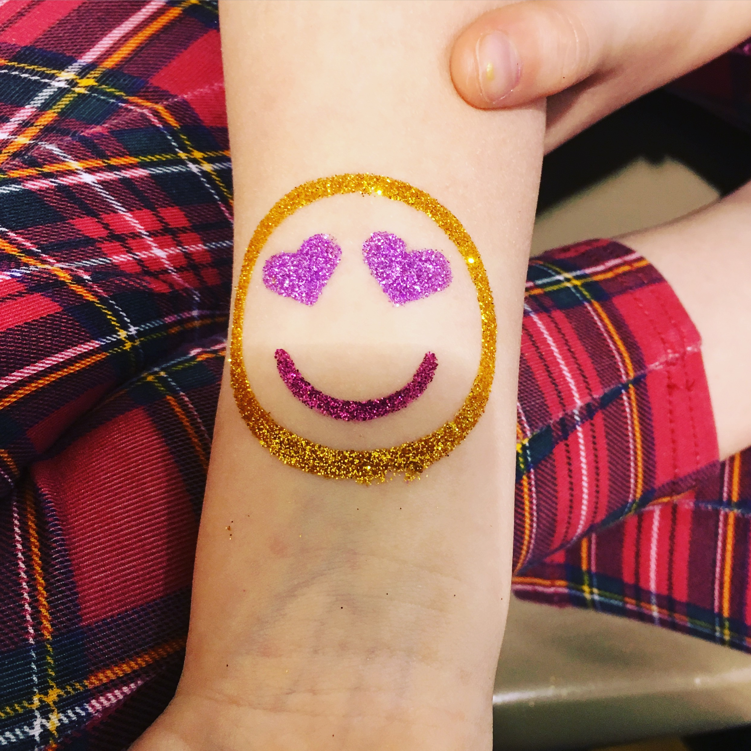 Emoji glitter tattoo