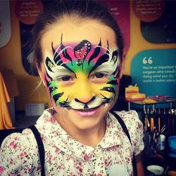 Rainbow tiger face paint