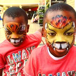 Lion and tiger face paints