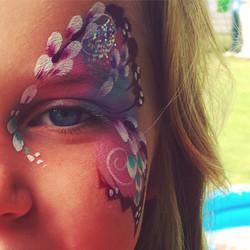 Butterfly face paint eye design.