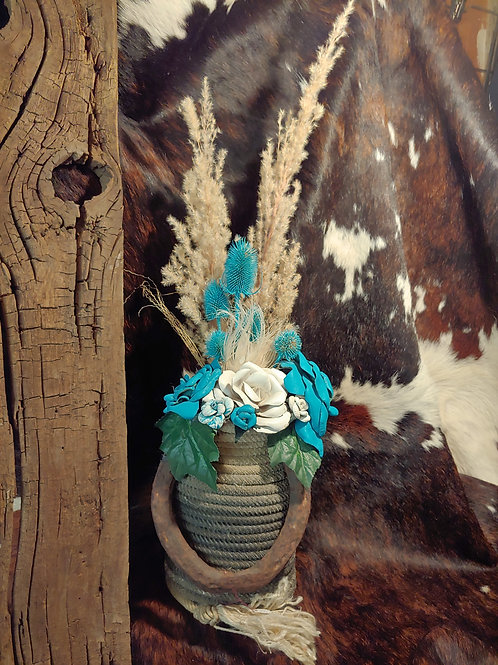 Rope vase with old horse shoe-