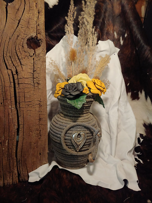 Rope vase with yellow and black leather roses
