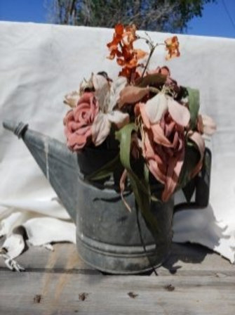 Old oil can with leather roses