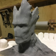 Character cut from PU foam, sprayed with primer ready for a paint test