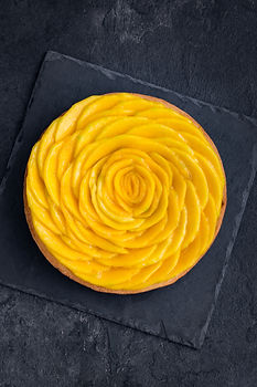 delicious mango tart on dark background.