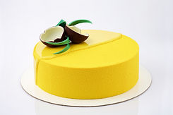 Yellow tropical mousse cake decorated wi