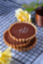 Chocolate tarts on a cooling rack.jpg