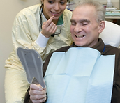 Picture of a man and woman in a dental office