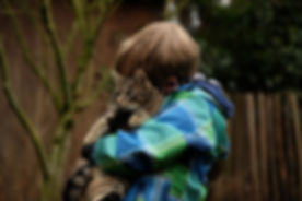 child hugging cat.jpg